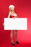Santa woman pointing at blank whiteboard Royalty Free Stock Images