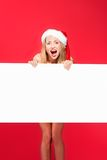 Santa woman pointing at blank whiteboard Stock Photo