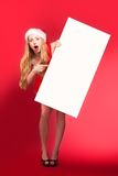 Santa woman pointing at blank whiteboard Stock Image