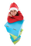 Santa woman posing with pile of present boxes Stock Photo
