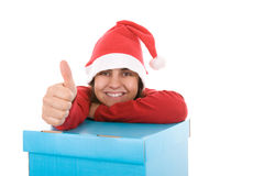 Santa woman posing with pile of present boxes Stock Image
