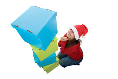 Santa woman posing with pile of present boxes Stock Images