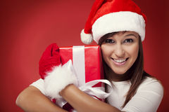 Santa woman with present Stock Photography