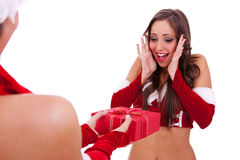 Santa woman receiving a nice present Royalty Free Stock Photography