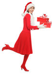 Santa woman running with gifts Stock Photo