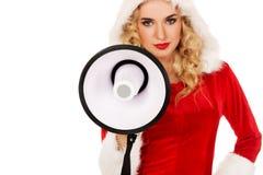 Santa woman screaming by megaphone Stock Image