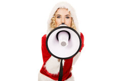 Santa woman screaming by megaphone Royalty Free Stock Photos