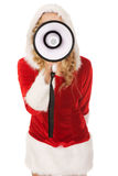 Santa woman screaming by megaphone Royalty Free Stock Photography