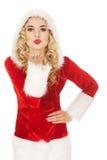 Santa woman sending a kiss or blow on hand Royalty Free Stock Image