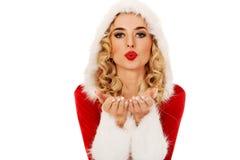 Santa woman sending a kiss or blow on hand Royalty Free Stock Photos