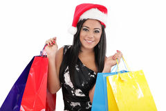 Santa woman with shopping bags Royalty Free Stock Photos