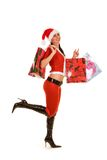 Santa woman with shopping bags Stock Image
