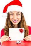 Santa woman showing gift card Stock Photography