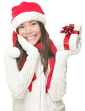 Santa woman showing gift smiling - christmas Royalty Free Stock Photography