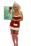 Santa woman showing gift smiling - christmas Stock Image