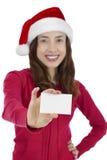 Santa woman showing sign card Stock Photo