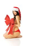 Santa woman sitting covering her body by ribbon Stock Photography