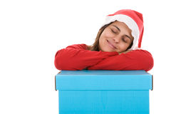 Santa woman sleeping on top present box Royalty Free Stock Photography