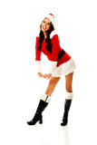 Santa woman standing astride and inclined. Attractive santa woman standing astride and inclined Stock Photo