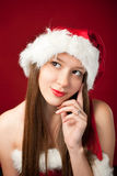 Santa woman thinking about who deserves gift! Royalty Free Stock Photo