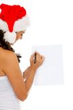Santa woman writing Stock Image