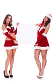 Santa women holding  a blank board Royalty Free Stock Photos