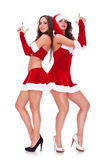 Santa women posing as secret agents Stock Images