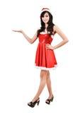 Santa women presenting something on  hand Royalty Free Stock Image
