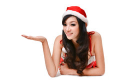 Santa women presenting something on  hand Royalty Free Stock Photo