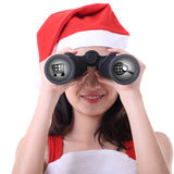 Santa women use binoculars for search Stock Image
