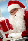 Santa working Stock Photos