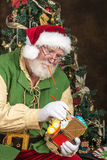 Santa in workshop Royalty Free Stock Image