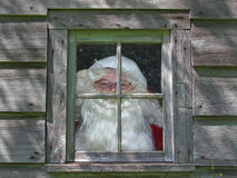 Santa in workshop window Stock Photo