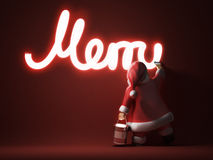 Santa writes Merry Christmas Stock Images