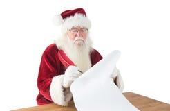 Santa writes something with a feather Stock Photos