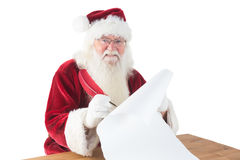 Santa writes something with a feather Stock Image