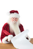 Santa writes something with a feather Stock Images