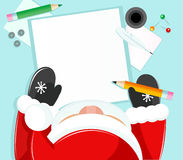 Santa writing Stock Image