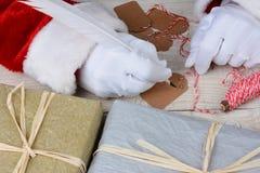 Santa Writing Gift Tags Imagenes de archivo