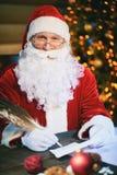 Santa writing letter Royalty Free Stock Image