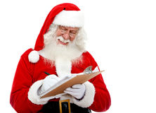 Santa writing a list Royalty Free Stock Photography