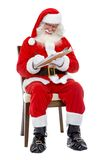 Santa writing a list Stock Photo