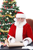 Santa writing list gifts Royalty Free Stock Photo