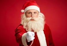 Santa wskazuje przy tobą fotografia stock