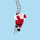 Santa wspina się drabinę Fotografia Royalty Free