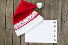 Santa's hat with paper on boards. Royalty Free Stock Images