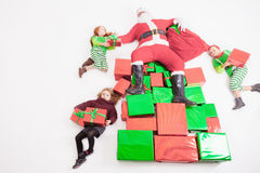 Santa's helpers working at North Pole. He reading wishes list Royalty Free Stock Images