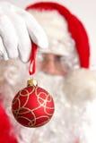 Santa with xmas ball Stock Images