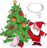 Santa y conejito Foto de archivo libre de regalías
