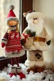 Santa y duende imagenes de archivo